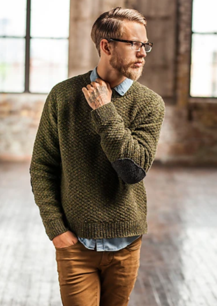 A man in a knitted pullover