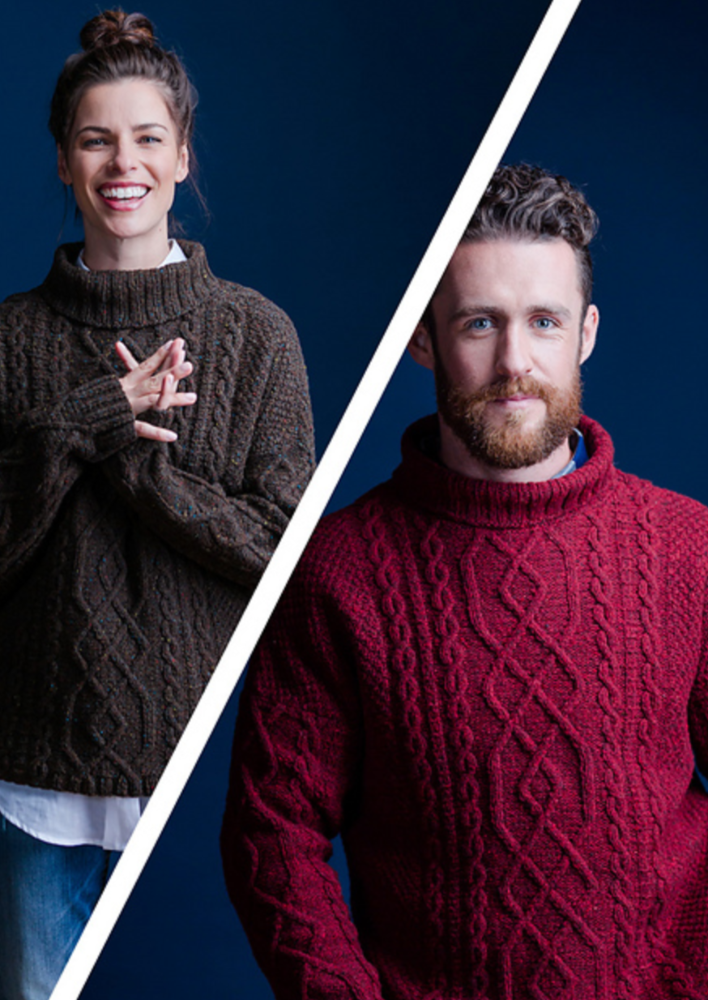 A man and a woman wearing a cabled, knitted sweater
