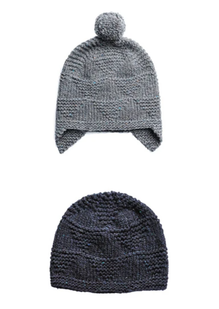 Two knitted hats on a white background