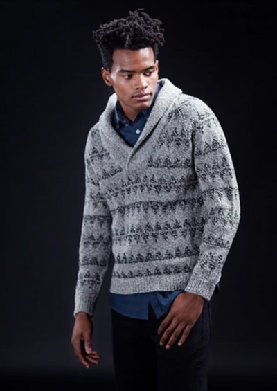A man wearing a knitted sweater