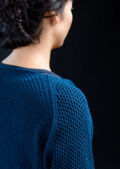 A woman wearing a knitted sweater