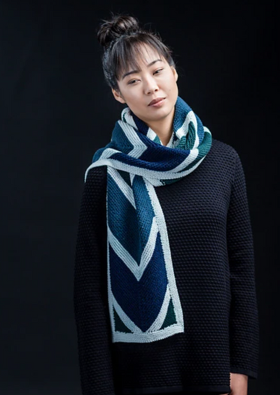 A woman wearing a knitted scarf