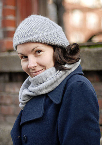 A woman wearing a knitted hat