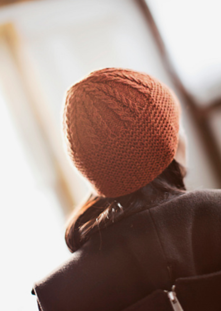 A person wearing a knitted beanie