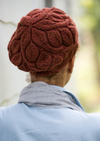 A woman wearing a knitted beret