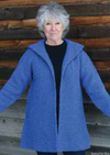 A woman wearing a knitted blue coat
