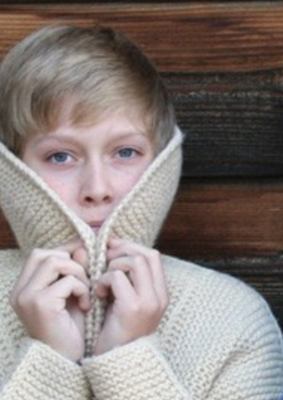 A child wearing a knitted coat