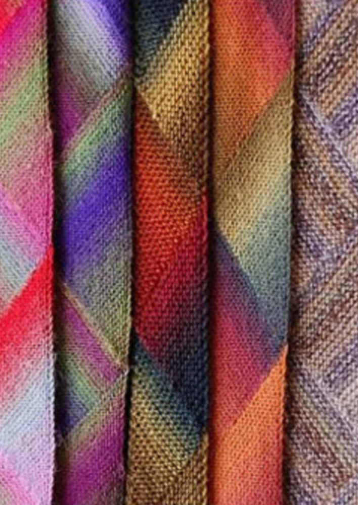 A group of multicolored scarves