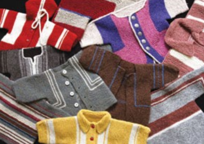 A group of knitted children's jackets