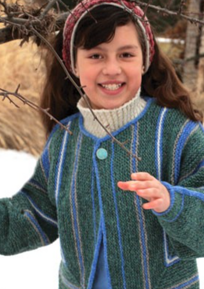 A young girl wearing a knitted jacket