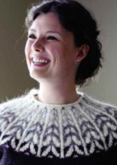 A woman wearing a colorwork sweater