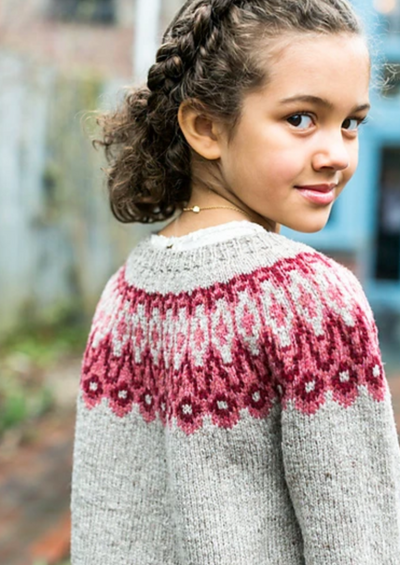 A girl wearing a knitted sweater