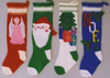 A row of four knitted stockings