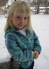 A female child wearing a knitted cardigan