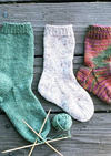 Three knitted socks and needles