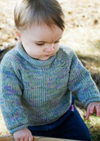 A baby wearing a knitted sweater