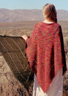 A woman wearing a knitted shawl