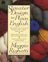 Skeins of yarn behind Sweater Design in Plain English by Maggie Righetti