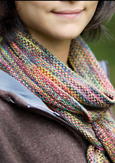 Woman wearing multi colored scarf