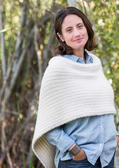 A woman wearing a knitted poncho