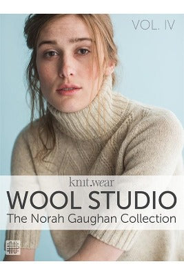 "The book cover of ""Wool Studio: The Norah Gaughan Collection,"" which features a woman wearing a knitted sweater looking at the reader."