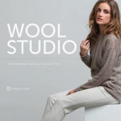 "The book cover of ""Wool Studio,"" which features a seated woman in a knitted, beige sweater."