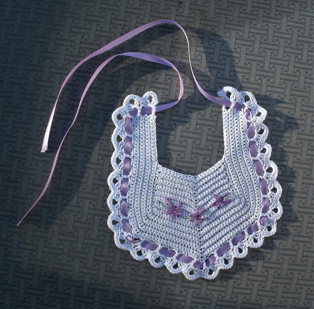 Already in a tissue-lined box, this Bib and Booties set is hand crocheted.