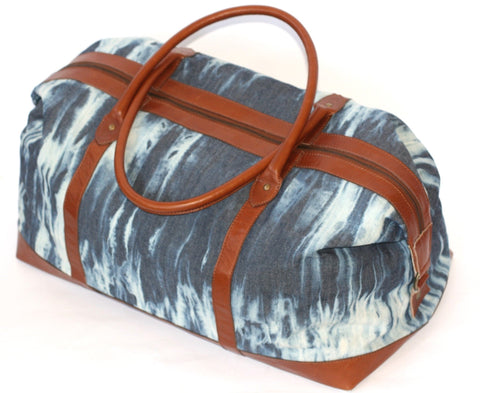 Handmade Shibori Cotton-Denim Indigo and White Duffle Bag with Red-Brown Leather Lining and Handles. Zipper Closure.