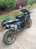 Venom Super Pocket Bike x19 Pocket Rocket 110cc in black sitting sideways revealing gold rims, gold foot pegs, dual exhaust pipe, 19 on rear seat