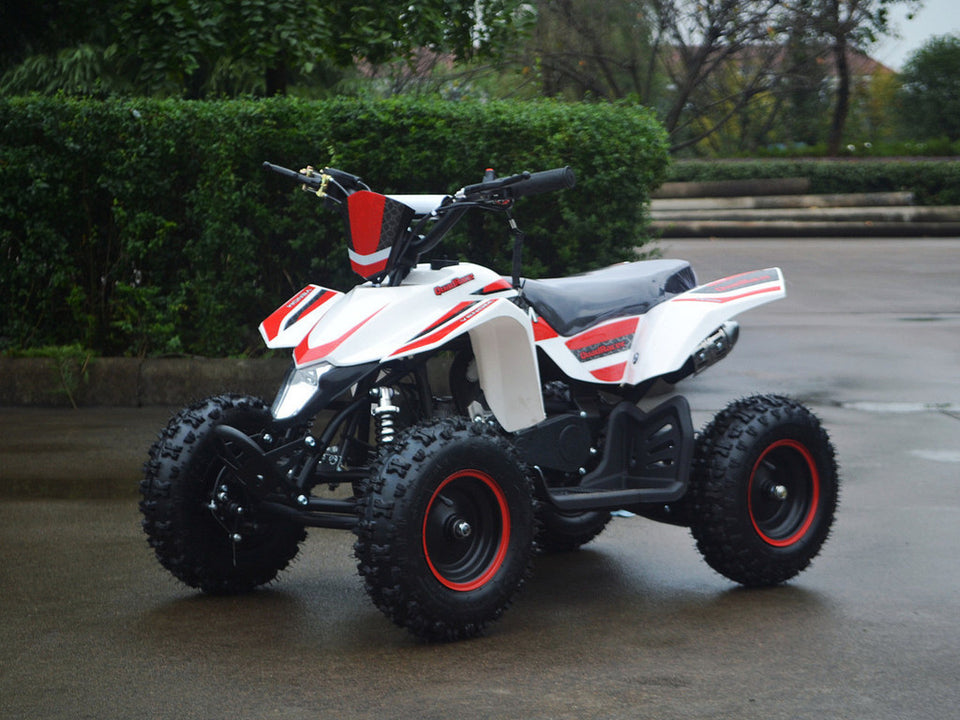 49cc Mini Quad ATV in red/white combo parked diagonally facing forward to the left