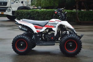 49cc Mini Quad ATV in red/white combo parked sideways revealing the right side of ATV and 49cc engine and red matching rims