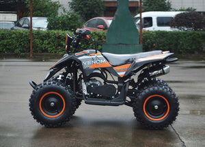 49cc Mini Quad ATV in orange/black combo parked sideways revealing left side of ATV when sitting on it