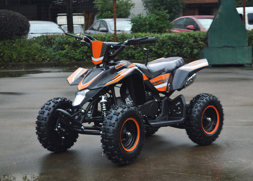 49cc Mini Quad ATV in orange/black combo parked diagonally facing forward to the left