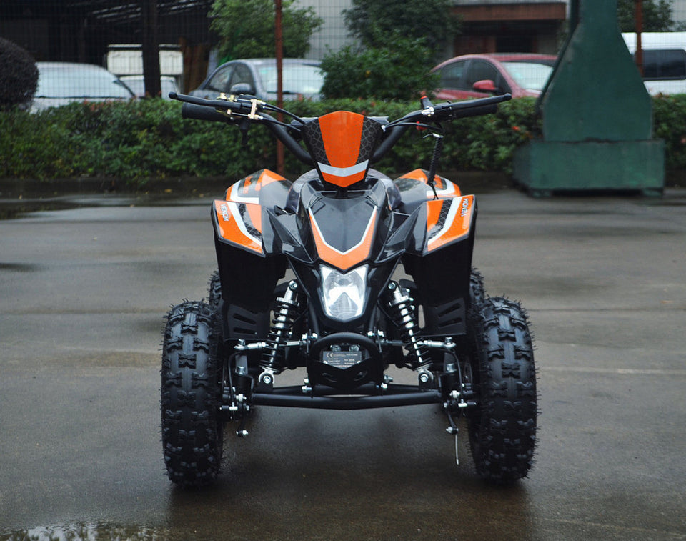 49cc Mini Quad ATV in orange/black combo parked forward revealing headlight area and front of ATV