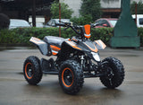 49cc Mini Quad ATV in orange/black combo parked diagonally facing forward to the right