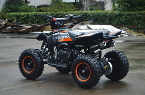 49cc Mini Quad ATV in orange/black combo parked diagonally facing its rear to the left side of ATV revealing dual exhaust pipes and free upgrade to matching orange rims