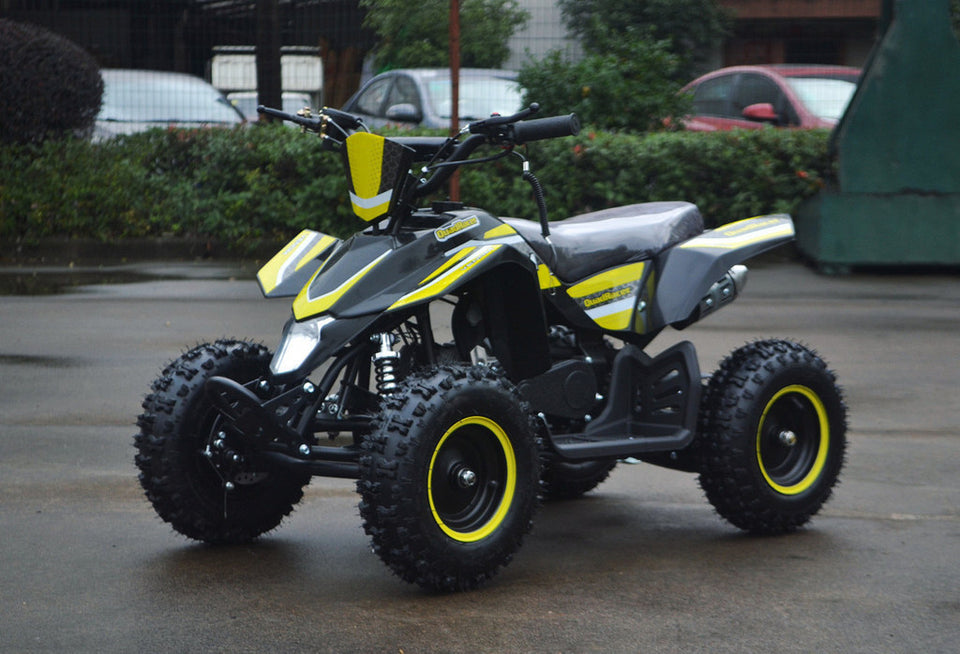 49cc Mini Quad ATV in yellow/black combo parked diagonally facing forward to the left