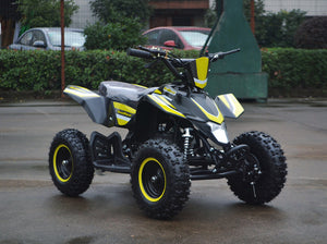 49cc Mini Quad ATV in yellow/black combo parked diagonally facing forward to the right