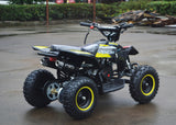 49cc Mini Quad ATV in yellow/black combo parked diagonally facing its rear showing dual exhaust pipes and free upgrade to matching yellow rims