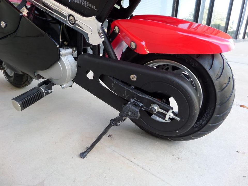Red and black 40cc premium gas pocket bike 4-stroke rear tire close up and bike stand.