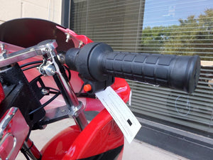 Red and black 40cc Premium Gas Pocket Bike 4-Stroke throttle zoomed in on revealing kill start button.