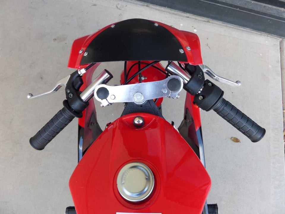 Sitting down view of 40cc Premium Gas Pocket Bike 4-Stroke in red/black combo facing forward revealing throttle and brake handles. Mostly red paint revealed, black windshield