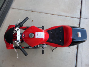 Birds eye view of 40cc Premium Gas Pocket Bike 4-Stroke in red/black combo with handles sticking out. Main body in red paint and rear of bike in black paint.