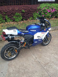 Venom Super Pocket Bike x19 Pocket Rocket 110cc in blue and white yamaha edition color combo with racing stickers all around bike sitting sideways dual high performance exhaust pipes