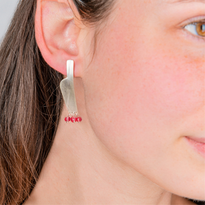 silver long earrings with red stones. handmade in Sydney. modern satin finish jewellery for special event