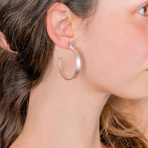 lage round silver hoops with texture. summer earrings. special gift. women who wearing hoops