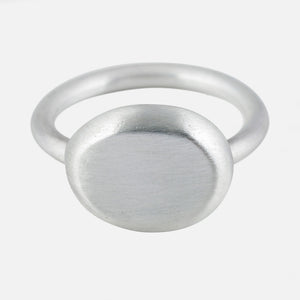 silver organic oval top solid rind in a satin finish.