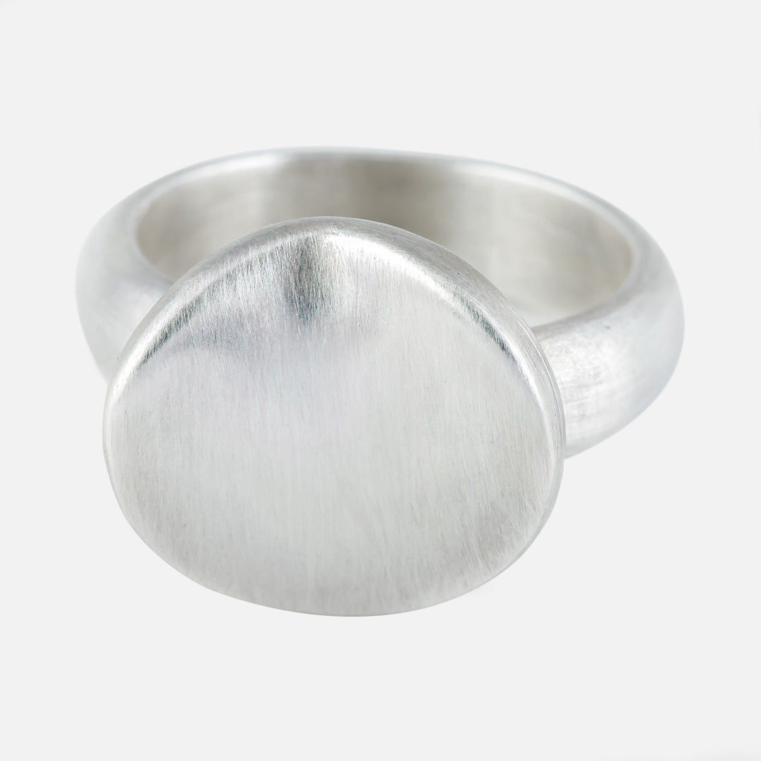 silver oyster shape ring. A wavy round organic modern ring.