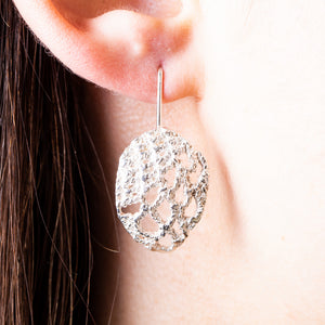 silver texture womens earrings. Drop hooks. Modern fabric.