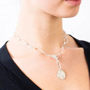 silver chain necklace with handmade pendant and diamond set.